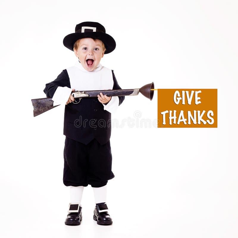 det lyckliga barnet vallfärdar tacksägelse royaltyfri bild