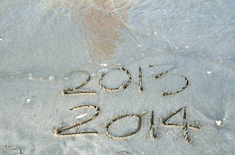 Det nya året 2014 är det kommande begreppet royaltyfri foto