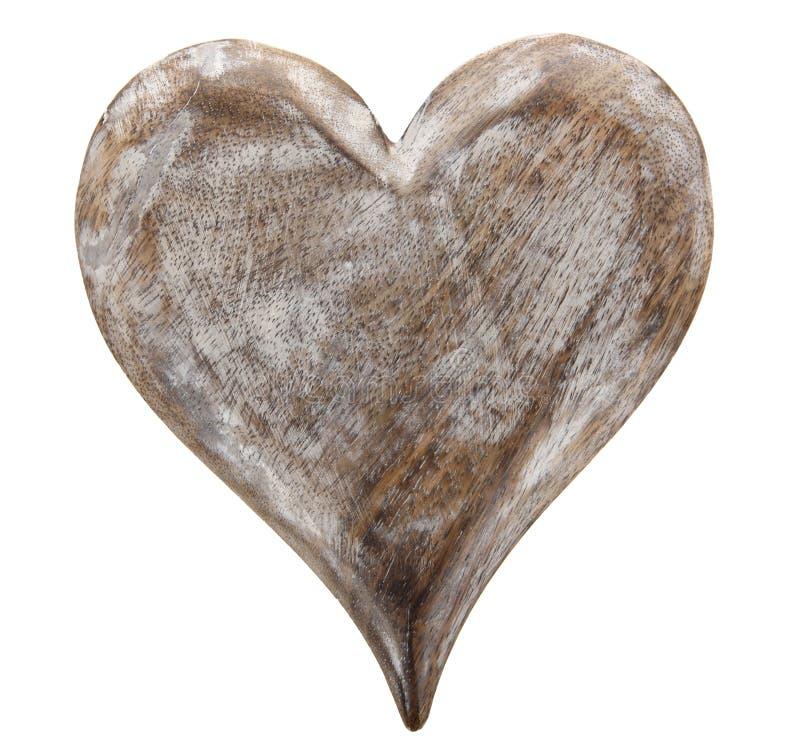 Det pappers- hålet rev sönder i hjärta Shape med gammal Wood bakgrund inom arkivfoto
