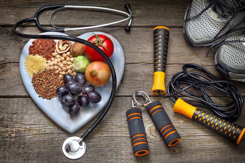 Det sunda livsstilbegreppet med bantar och kondition royaltyfri fotografi