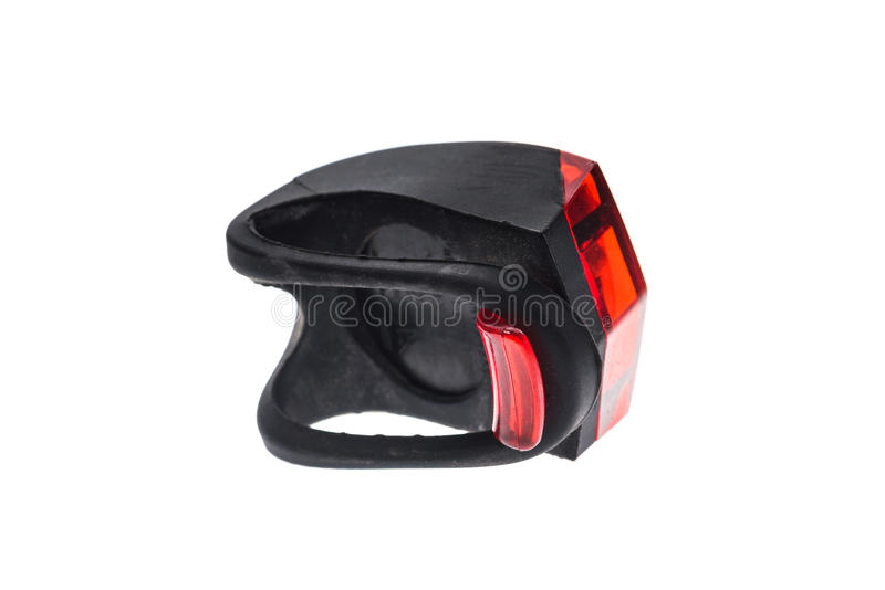Detachable bicycle safety red blinking tail LED light. Rubber black and red LED bike light with power switch with removable strap stock photos