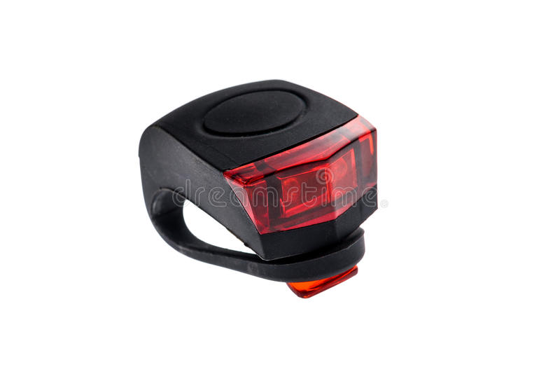 Detachable bicycle safety red blinking tail LED light. Rubber black and red LED bike light with power switch with removable strap royalty free stock photos