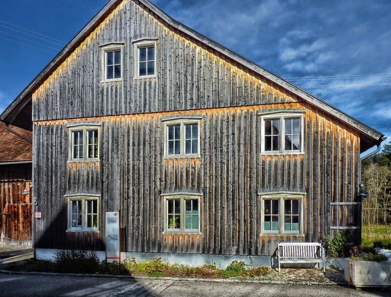 Detached house with wooden cladding stock photo