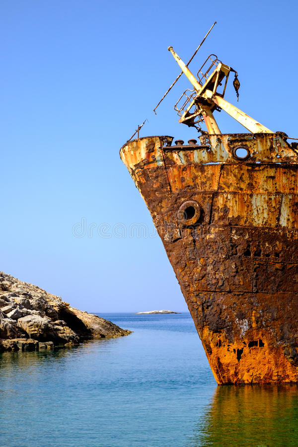 Detail of abandoned rusty shipwreck on Amorgos island. Cyclades, Greece stock photos