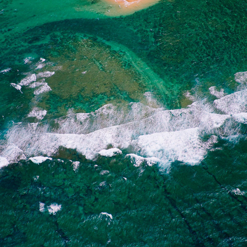 Detail abstract view of ocean waves from helicopter royalty free stock photo