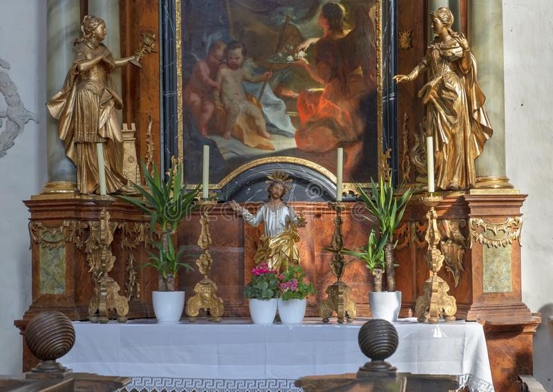 Detail of the altar on the northern nave wall with painting Saint Jospeh, Interior Piarist Church, Krems on the Danube, Austria. Pictured is detail of the nave royalty free stock image