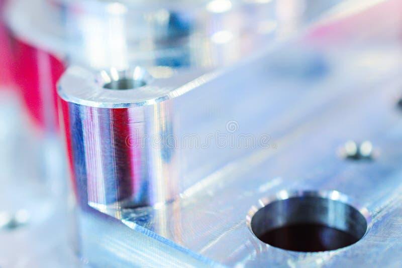 Detail of aluminum machined parts, shiny surface. royalty free stock photo
