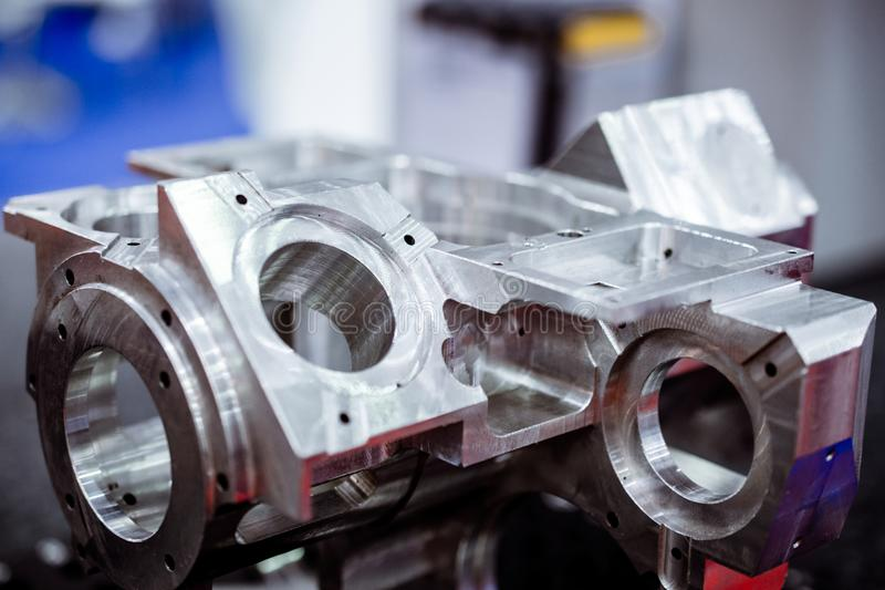 Detail of aluminum machined parts, shiny surface. royalty free stock images