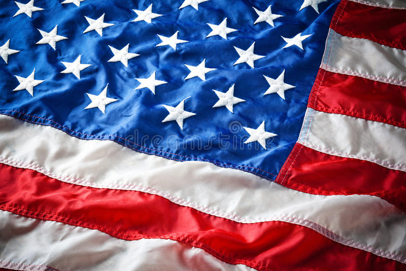 Detail of American Flag Stars. USA american flag detail features white stars on blue field with red and white stripes stock image
