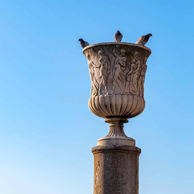 Pisa, Italy: `Piazza dei Miracoli`. Detail of the amphora of the Bacchantes, located on the column on the side of the cathedral, in Piazza dei Miracoli in Pisa royalty free stock photo