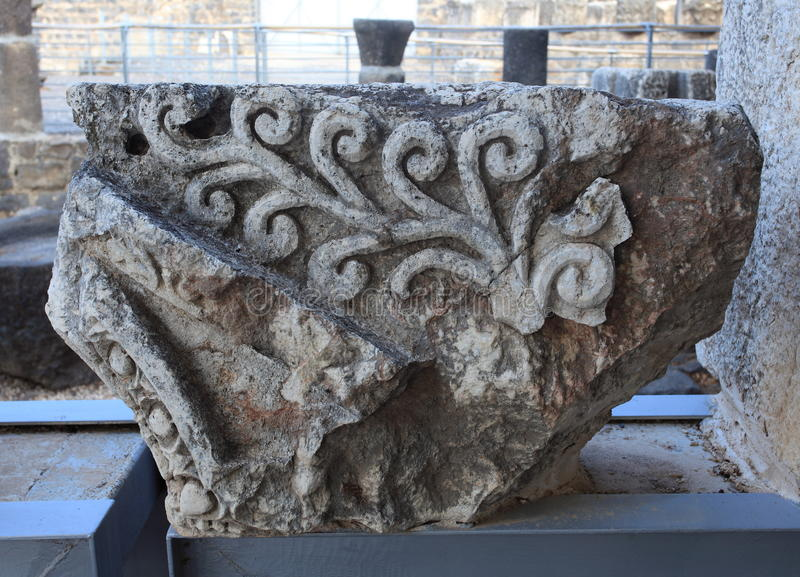 Detail of an Ancient Capital in Capernaum stock photos