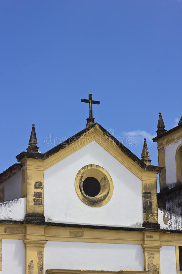 Detail of an ancient church in Olinda, Recife, Brazil. With blue sky at the background royalty free stock photos