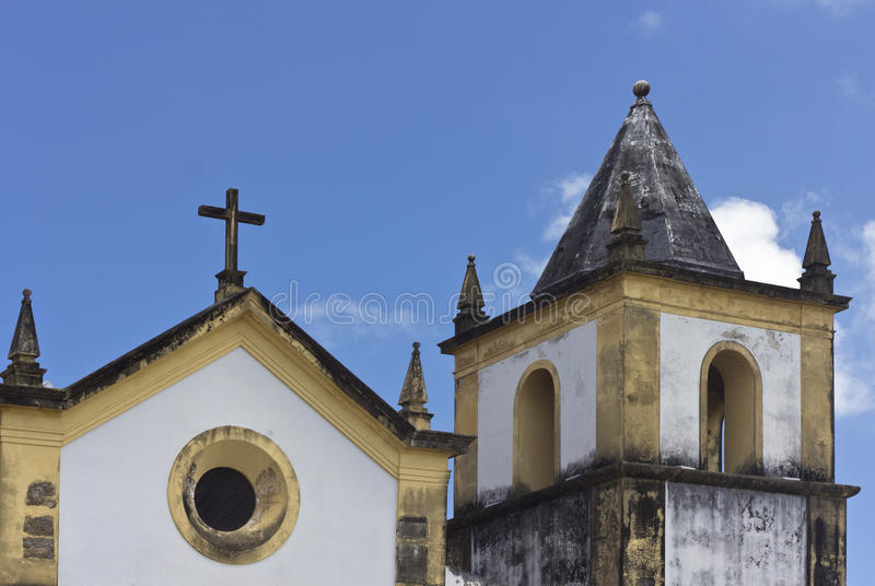 Detail of an ancient church in Olinda, Recife, Brazil. With blue sky at the background royalty free stock photo