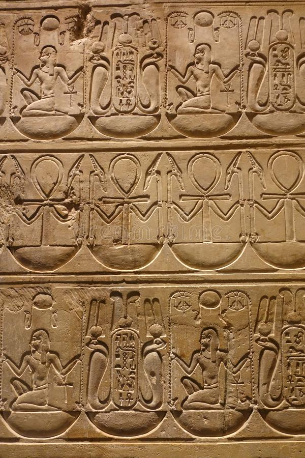 Detail of Ancient Hieroglyphics. Detail of Egyptian hieroglyphic carving featuring the symbol of the ankh, photographed at French museum stock images