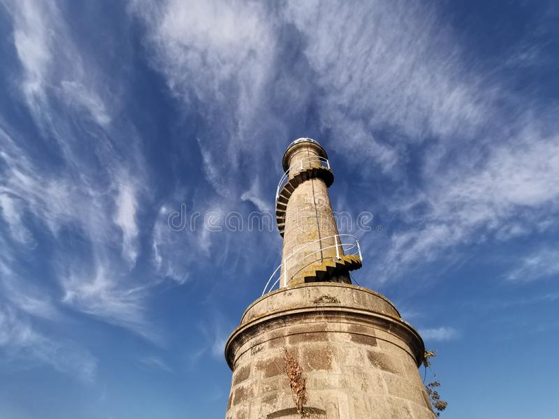 Detail of ancient lighthouse that facilitates navigation and maritime safety. Hdrpl stock photo