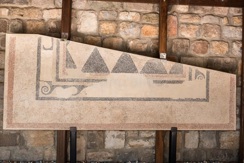 Detail of an ancient wall on exhibition royalty free stock image