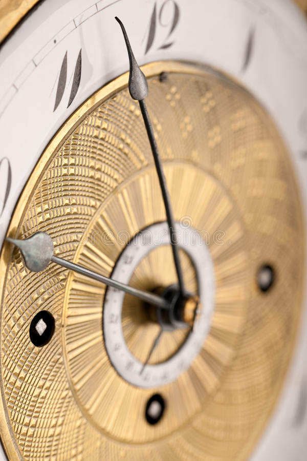 Detail of antique clock with Arabic numeral stock images