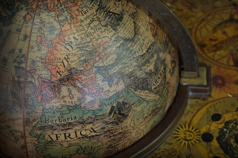 Antique terrestrial globe. Detail of antique old world terrestrial globe with map of Europe and Africa stock photos