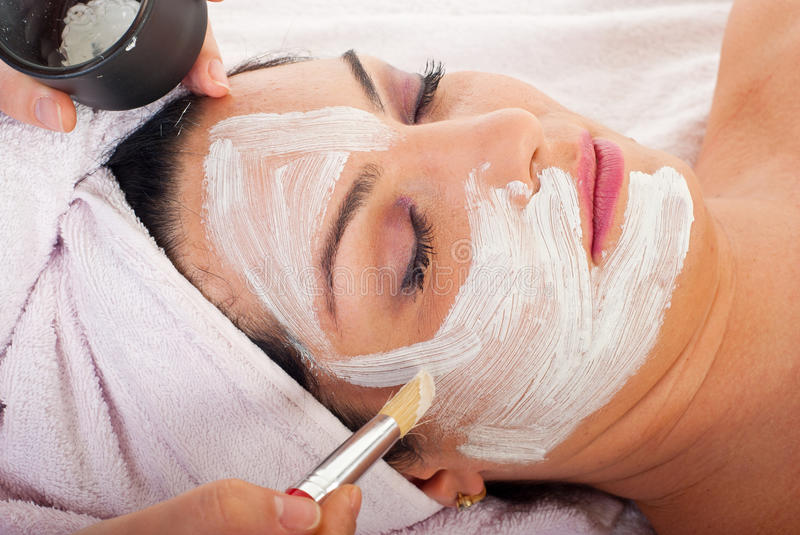 Detail of applying facial mask stock photography