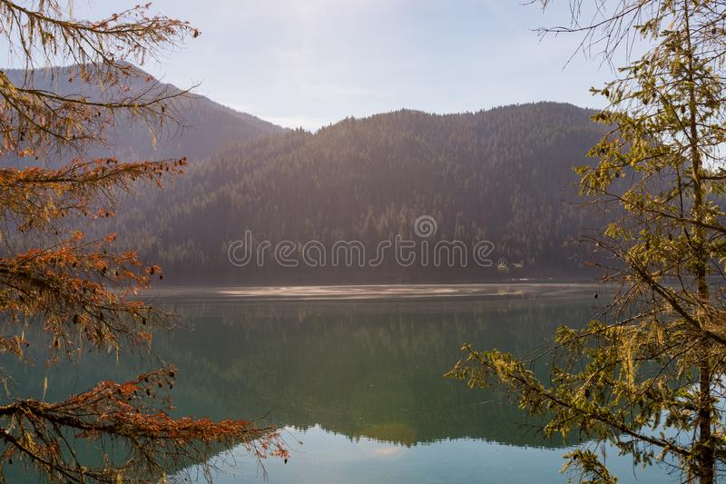 Detail of Baker Lake water, shore and trees, in Norh Cascades. Washington stock photos