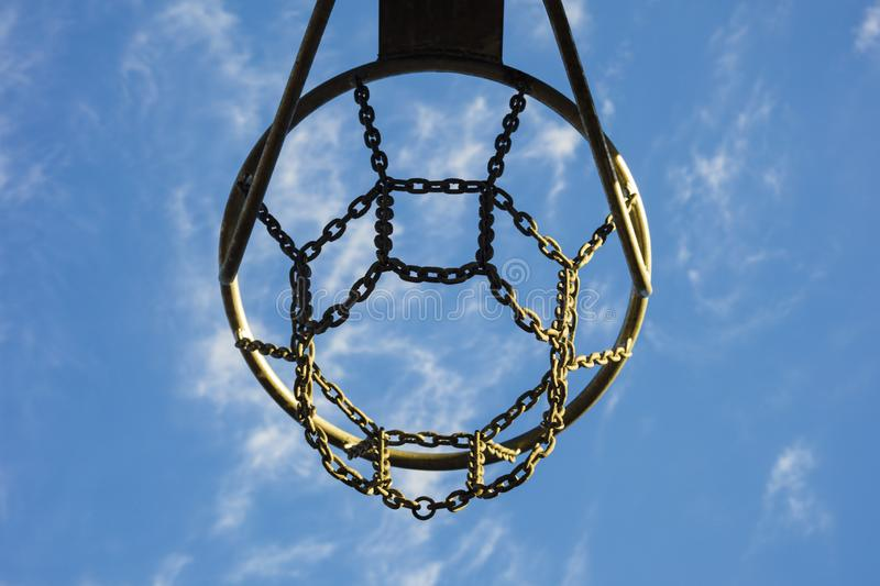 Detail of basketball basket outdoors in blue sky stock images