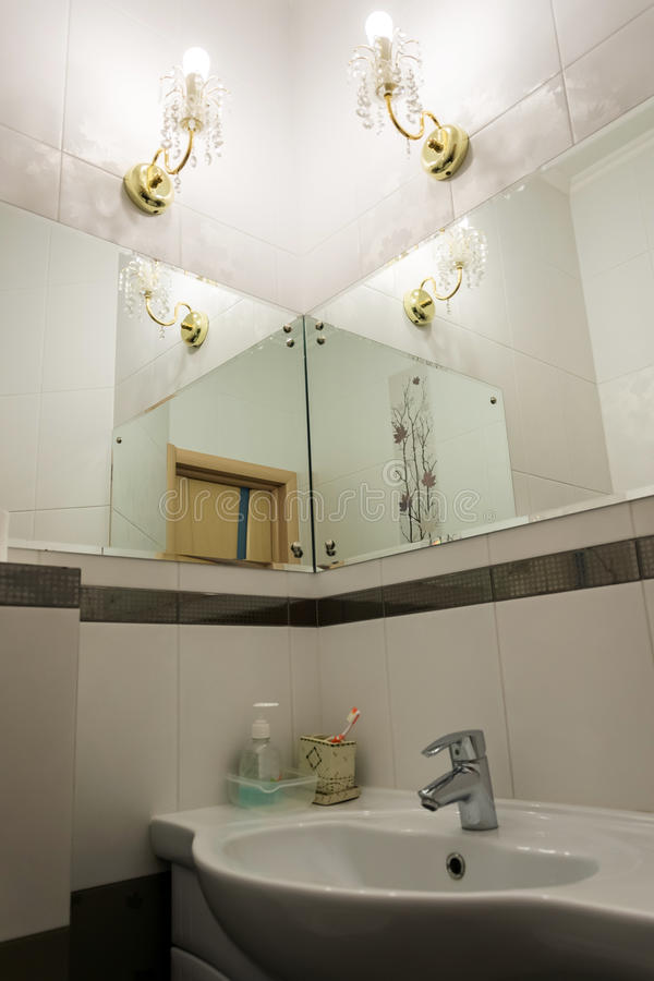 Detail of bathroom with mirrors. Detail of a bathroom with mirrors stock images