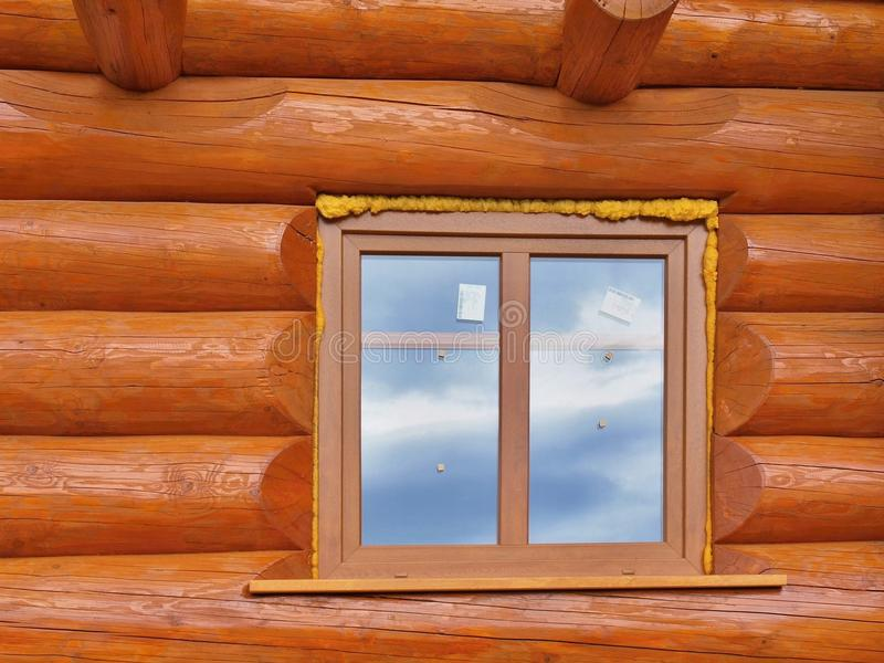 Detail of beams in cabin wall. Painted wood with fungicide paint and wooden window royalty free stock image