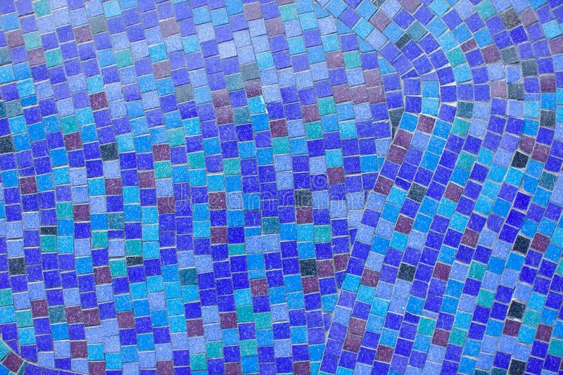 Detail of a beautiful crumbling abstract ceramic mosaic decoration. Background and texture. Detail of a beautiful crumbling abstract ceramic mosaic decoration royalty free stock images