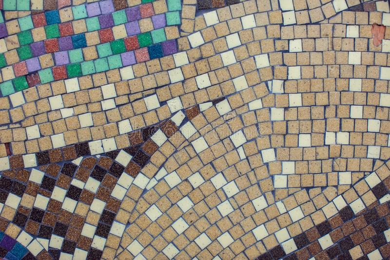 Detail of a beautiful crumbling abstract ceramic mosaic decoration. Background and texture. Detail of a beautiful crumbling abstract ceramic mosaic decoration stock photo