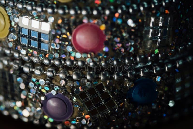 Detail of a beautiful crumbling abstract glass mosaic decoration. Decorative background. Selective focus. Closeup macro view. Horizontal royalty free stock photo
