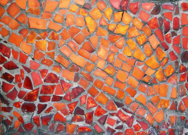 Detail of a beautiful old crumbling abstract ceramic mosaic. Building decoration, decorative background. Abstract design. Abstract mosaic colored ceramic stones royalty free stock image