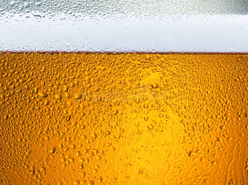 Detail of beer drops on glass stock images