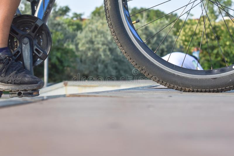 Detail of bicycle wheel and pedal in bicycle performance park stock photo