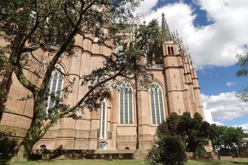 Buenos Aires La Plata Cathedral. Detail of the big large windows of the cathedral. Building of Neogothic style located opposite to the square Dark man in the royalty free stock photo