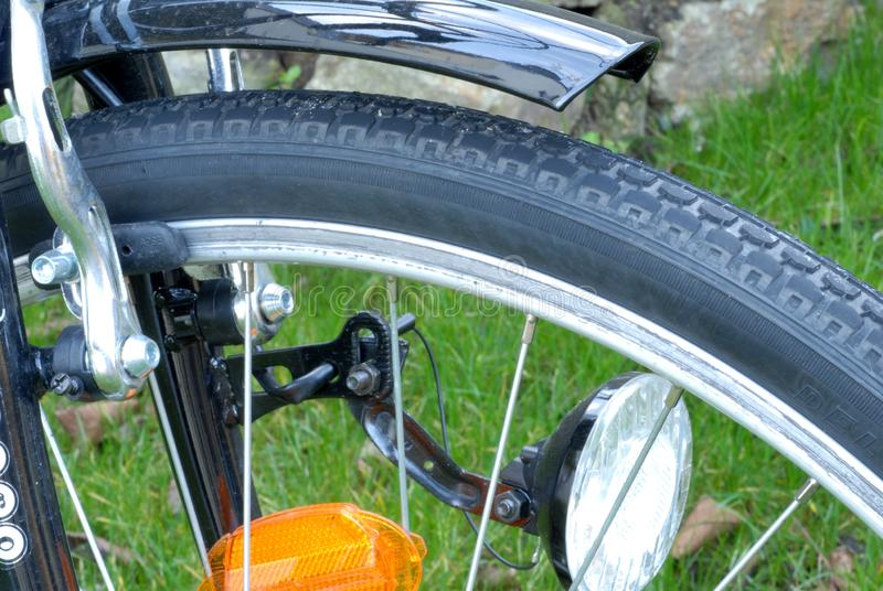 Detail of a bike. Wheel, headlight and tire of a bike in close up royalty free stock image