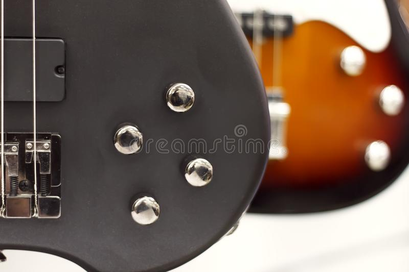 Electric guitar close-up with a soft focus of black color, tone controls, volume. stock photography