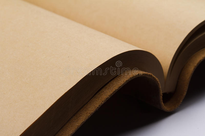 Detail of blank pages of a leather covered book. Close up of empty pages of a leather covered book binding stock image