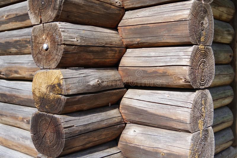Detail from the blockhouse. Round wooden beams interlocked, Corner connection at the blockhouse, round wooden beams with visible grain, wooden hut, round wooden royalty free stock photos