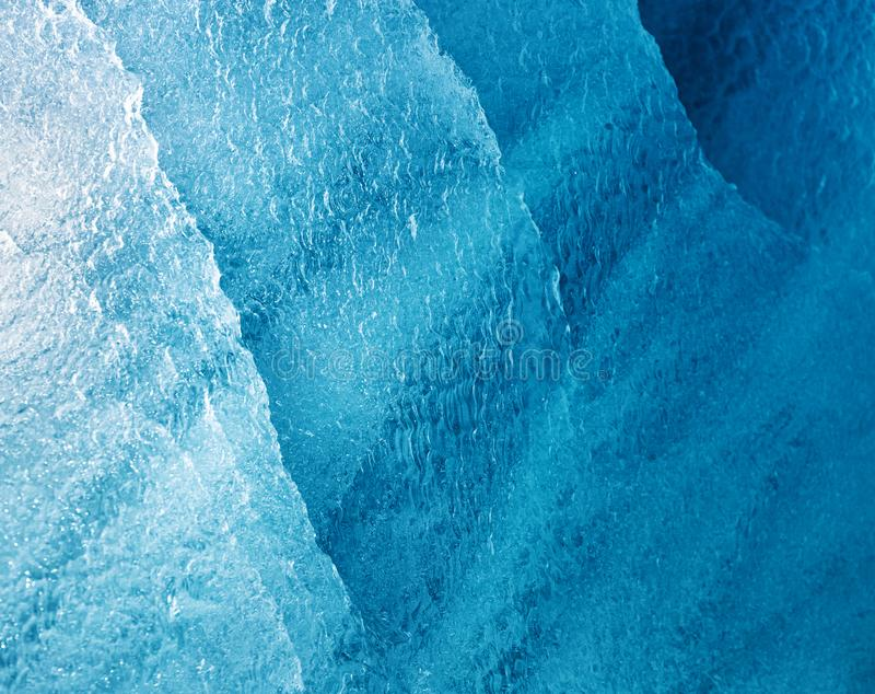 Detail of a blue glacial iceberg. In Svalbard, a Norwegian archipelago between mainland Norway and the North Pole stock image