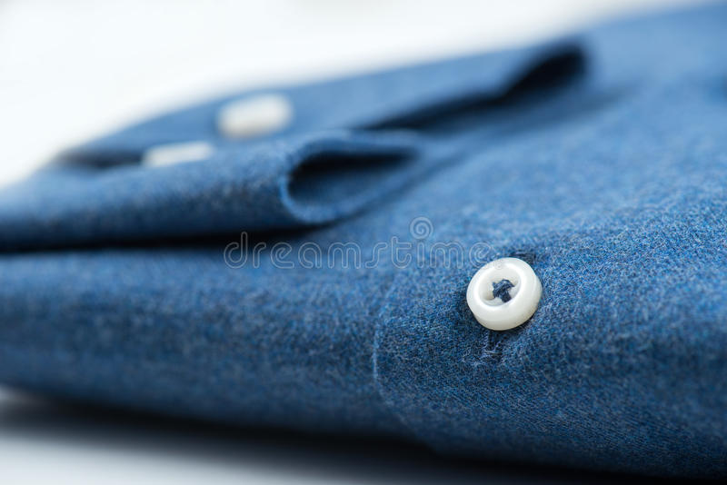 Detail on blue shirt royalty free stock image