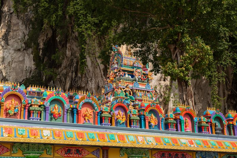Detail of brightly coloured architecture surrounding the entrance to Temple Cave. Part of the Batu Caves site at Gombok, near Kula Lumpur, Malaysia royalty free stock images