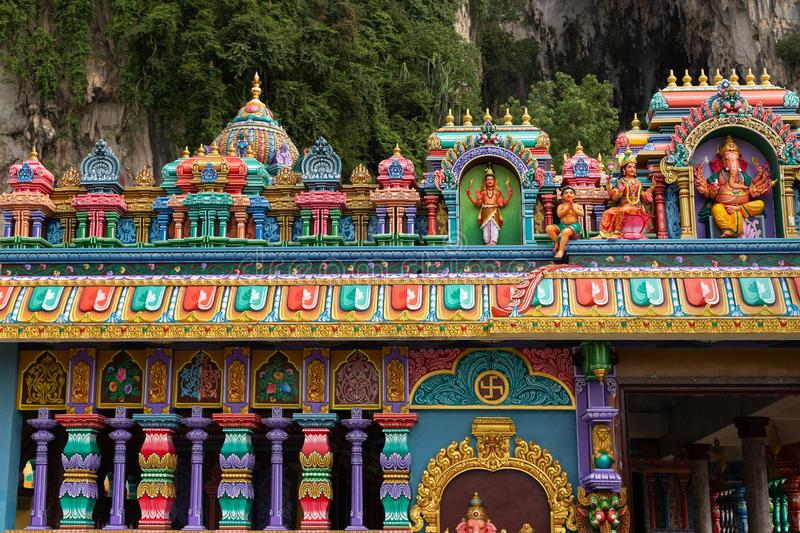Detail of brightly coloured architecture surrounding the entrance to Temple Cave. Part of the Batu Caves site at Gombok, near Kula Lumpur, Malaysia stock photography