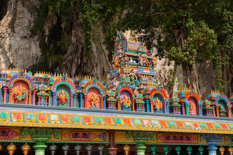 Detail of brightly coloured architecture surrounding the entrance to Temple Cave. Part of the Batu Caves site at Gombok, near Kula Lumpur, Malaysia royalty free stock photography