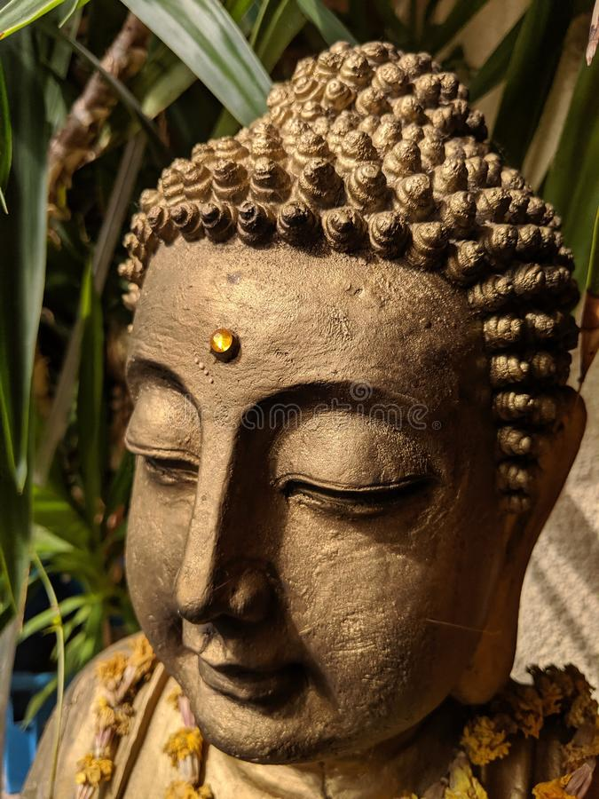 Detail of a Buddha statue stock photo