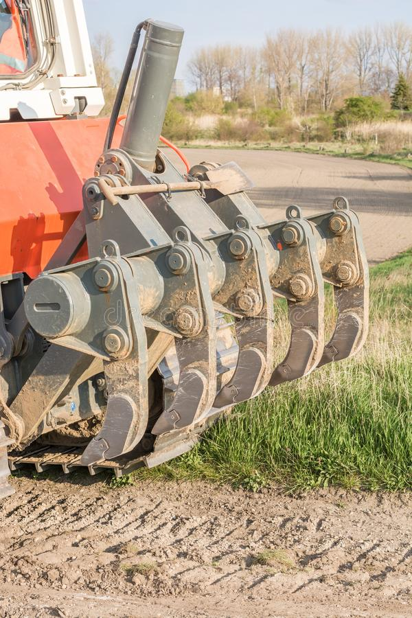 Ripper on a bulldozer in detail stock image