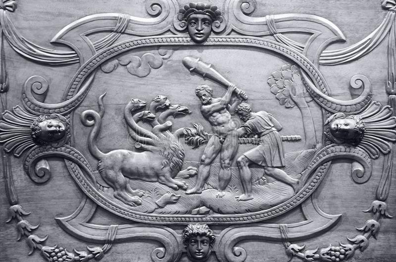 Detail of a cabinet with images of heroic deeds of Heracles. YAROSLAVL, RUSSIA - JUNE 30, 2016: a detail of a cabinet with images of heroic deeds of Heracles in stock photos