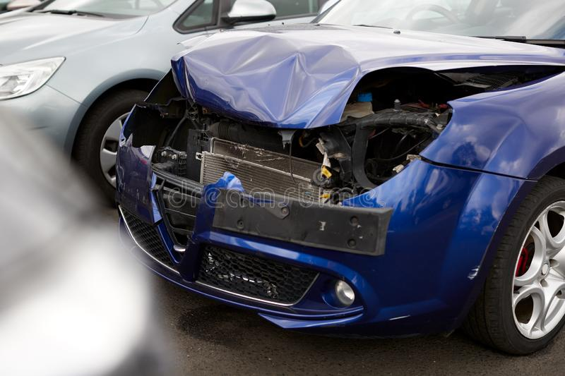Detail Of Car Damaged In Motor Vehicle Accident Parked In Garage Repair Shop stock images