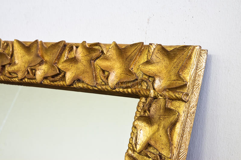 Detail of a carved and golden wooden frame stock photo
