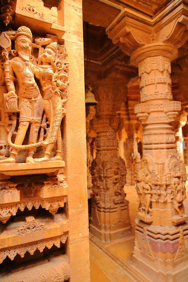 JAISALMER, RAJASTHAN, INDIA - DECEMBER 21, 2017: Detail of the carvings inside Rikhabdev Temple, a Jain Temple located inside the stock photography