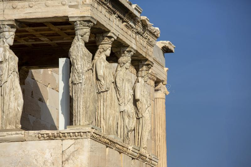Detail of caryatids statues on the Parthenon on Acropolis Hill, Athens, Greece. Figures of the Caryatid Porch of the Erechtheion royalty free stock images